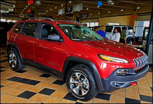 A 2014 Jeep Cherokee Trailhawk is displayed at Charlie's Dodge in Maumee. One expert predicts sales of 80,000 to 100,000 Cherokees a year in the United States.
