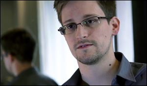 Edward Snowden worked as a contract employee at the National Security Agency in Hong Kong. The Guardian identified Snowden as a source for its reports on intelligence programs after he asked the newspaper to do so on Sunday.