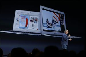 Phil Schiller the senior vice president of worldwide marketing at Apple introduces the new MacBook Air laptops during the keynote address of the Apple Worldwide Developers Conference  in San Francisco today.