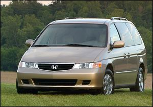 U.S. safety regulators have added about 320,000 older model Honda Odyssey minivans to a widening probe of faulty air bags.