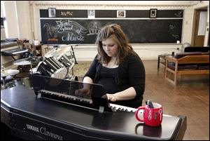 Carole Hoste, plays piano at the Detroit School of Music, a former Detroit Public School building, where she gives private music lessons.