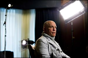 Actor John Malkovich speaks with media Thursday at the King Edward Hotel in Toronto to promote his new role as Casanova in The Giacomo Variations. That same day, a Defiance man's cross-country Canadian tour almost turned tragic when he fell walking on a Toronto sidewalk and a protrusion sticking out of the construction scaffolding slit his throat. Rescue came from an unlikely source: Malkovich.