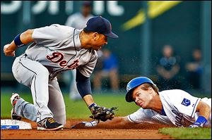 Detroit Tigers second baseman Omar Infante tags out the Royals' Chris Getz during the fourth inning on Monday night.