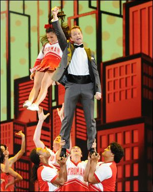 Neil Patrick Harris, who returned as emcee for the fourth time, performs with cheer-leaders for a number.