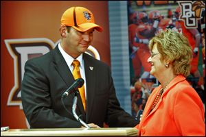Chris Kingston, left, smiles as he is welcomed as the 13th director of athletics at Bowling Green State University by school president Mary Ellen Mazey. Kingston, who received a five-year contract with a base salary of $245,000 per year, will begin July 15.