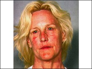 This Clark County Dentention Center booking photo shows environmental activist Erin Brockovich, 52, who was arrested late Friday on suspicion of boating while intoxicated at Lake Mead near Las Vegas.
