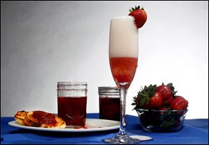 Strawberries, strawberry jam and champagne with strawberry and sugar.
