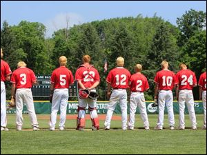 Bedford High School players, their hair dyed the same color for their tournament run, stand for the National Anthem before playing Howell High School in their Division I s