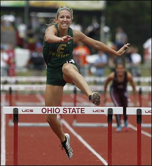Evergreen junior Carly Truckor races to a victory in the 300-meter hurdles in the Division II state track meet.