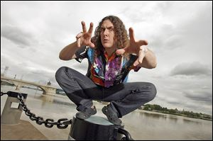 'Weird Al' Yankovic poses by the Maumee River for Blade photographer Andy Morrison in 2008.