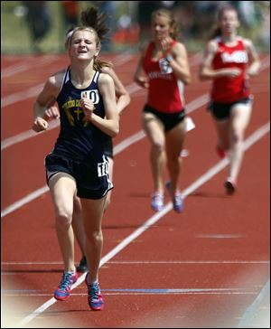 Toledo Christian senior Delainey Phelps runs wins the 3200-meter race in the Division III state meet.