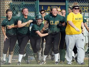 Clay's Brooke Gyori (with helmet) celebrates with teammates after scoring  the winning run against  Anthony Wayne in the Division I regional semifinal. The Eagles finished 26-4.