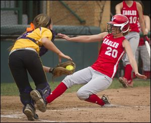 Eastwood's Morgan Corns scores ahead of the tag by Bloom-Carroll catcher Kipley Detwiler in the Division III state semifinals. The Eagles were 29-4.