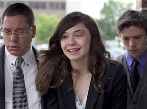 Transgender student Nicole Maines, center, with her father Wayne Maines, left, and brother Jonas, speaks to reporters.