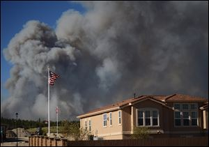 The Black Forest Fire burns northeast of Colorado Springs, Colo, Tuesday.
