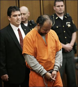 Ariel Castro walks into the courtroom during his arraignment today in Cleveland.  Castro, 52, is accused of holding three women captive in his Cleveland home for about a decade.