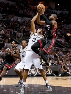 Miami's Dwyane Wade shoots over San Antonio's Boris Diaw is Thursday night's Game 4 of the NBA Finals. Wade finished with 32 points, six rebounds, and six steals.
