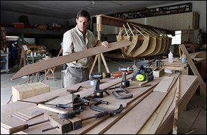 John Riddle works to build a replica of the longboat used by Comm. Oliver Hazard Perry during the Battle of Lake Erie in 1813 off Put-in-Bay. The pulling boat will be christened Saturday in Sandusky.