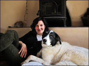 Heidi Schulman relaxes with her rescue dog, Bosco, in Santa Fe. Bosco inspired her to develop