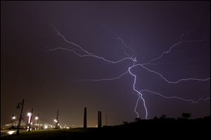 Bolts of lightning fill the sky as severe storms move through the Toledo area about midnight Wednesday.