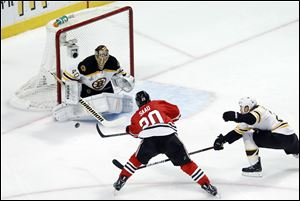Boston Bruins goalie Tuukka Rask (40) saves a shot by Chicago Blackhawks left wing Brandon Saad (20) during the first period.