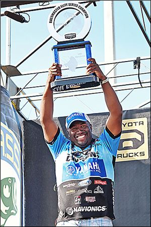 Ish Monroe lifts the Bassmaster Elite Series trophy after winning the tournament on Florida's Lake Okeechobee in 2012.