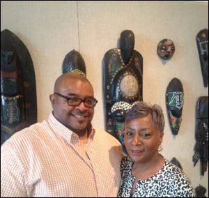 Darlene Roberts, right, poses with Odes Roberts, curator of the African Reflections Main Library exhibit.