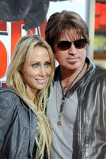 Billy-Ray-Cyrus-at-right-and-his-wife-Laeticia-Tish-Cyrus