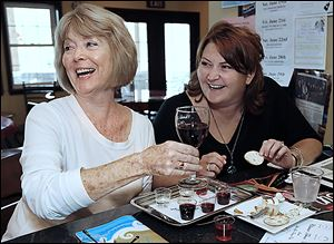 Patty Pastorek, left, of Oregon enjoys a glass of wine with daughter Kara Pastorek of Sylvania at Chateau Tebeau Winery.