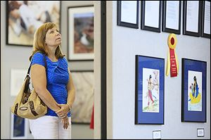 Amy Fell of Sylvania views the Art-A-Fair exhibit, which features more than 200 pieces by local artists.