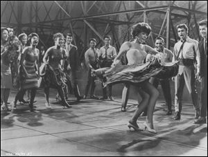 The 'West Side Story' sound­track was a fes­ti­val of over­dubs, with the mar­quee stars do­ing scarcely any of the sing­ing. Above, Rita Moreno dances during the Broadway production.