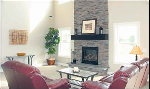 The great room's stone fireplace rises two stories, making a grand statement.