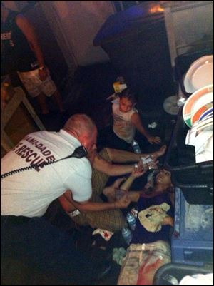 Victims of a deck collapse  at Shuckers Bar & Grill in Miami are treated by Miami-Dade first responders.