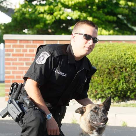 Speedy-with-his-handler-Sylvania-Township-Police-Offi