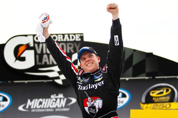 Regan-Smith-gets-out-of-his-car-and-celebrates-after-winning
