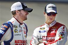 Dale-Earnhardt-Jr-left-talks-to-fellow-driver-Trevor-Bayne
