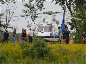 Rally-goers get a tour of a Life Flight helicopter during the second annual Middle Class Survival Rally in Monroe.