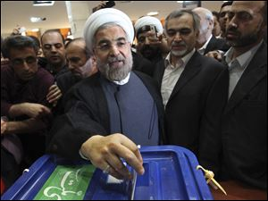 Iranian presidential candidate Hasan Rowhani, a former Iran's top nuclear negotiator, casts his ballot during presidential elections at a polling station in downtown Tehran, Iran, Friday. He was declared the winner of Iran's presidential vote today.