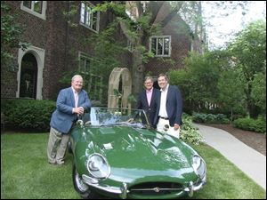 From left, host Carl Hedlund, Greg Knudson and Tom Downs stand next to a 1963 Jaguar that was on display to commemorate the 50-year members at the Country Garden Club's Tea and Wine soiree.