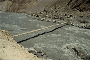 The ferocious Chitral River in northern Pakistan.