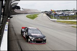 Dale Earnhardt, Jr., runs a practice lap for the Quicken Loans 400 at Michigan International Speedway.