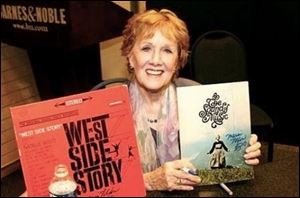 Marni Nixon holds album covers from 'West Side Story' and 'Sound of Music, two of the productions on which she worked.