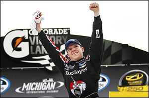 Regan Smith celebrates winning the Nationwide Alliance Truck Parts 250 at MIS, his second victory of the year.