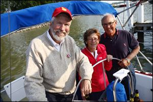 Maumee residents Gary Byers, and Barb and Larry King enjoy the
