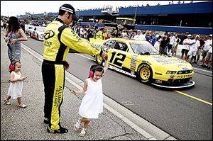 Sam Hornish, Jr. dances with his daughter Addison, 5, before the Nationwide race at Michigan International Speedway. Car problems caused Hornish to finish 32nd in the 39-car field.