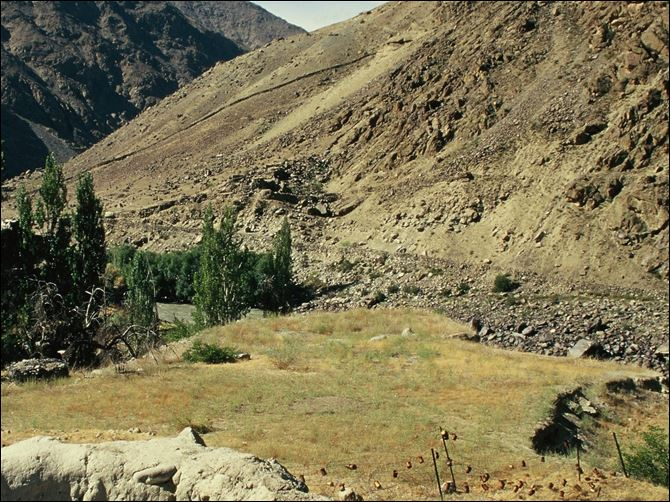 India and Pakistan  India and Pakistan come face to face in hostile posture in Kashmir. The small grassy knoll in the middle is no man's land. The famous Lasa-Skardu trail is half-way up the mountain on the right.