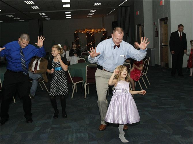 WEBp fatherdance16p Dads and daughters do the Cupid Shuffle at a dance last fall at Owens Community College.