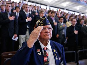 Jack Pietras of the Conn-Weissenberger American Legion Post 587, Toledo, salutes.