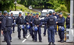 Riot police drill near the Lough Erne resort in Northern Ireland. Security preparations were under way Sunday for the G8 summit that starts today.