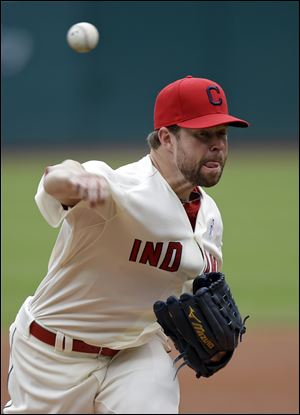 Cleveland Indians starting pitcher Corey Kluber delivers against the Washington Nationals.